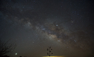 Pre-dawn Sagittarius area of the Milky Way with Venus, Saturn and Jupiter over the Dragoon Mountains in southern Arizona