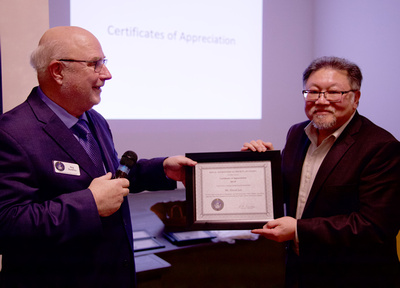 Reg presenting David Lee with a Certificate of Appreciation