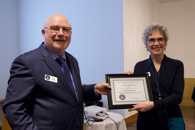 Reg presenting Marjie Welchframe with a Certificate of Appreciation