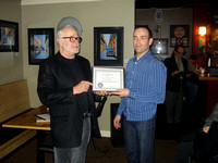 Nelson Walker presents service certificate to Charles Banville