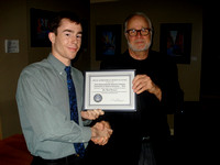 Matt Watson gets service certificate from Nelson Walker