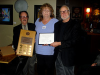 Sherry Buttnor receives Newton Ball Service Award from Bruno Quenneville and Nelson Walker