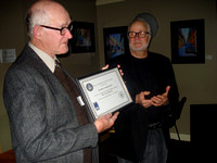John McDonald receives service certificate on behalf of Lauri Roche from Nelson Walker