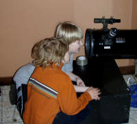 Young astronomers checking out some telescope optics