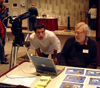 David Griffiths shows a Pearson College student how the Meade LPI webcam works