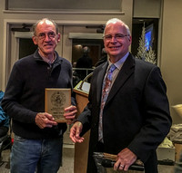 Terry Ryals receiving an award from President Chris Purse