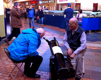 Sid demonstrates a telescope