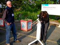 John McDonald shares a view of the sun with a visitor