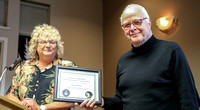 Nelson Walker receives his Certificate of Appreciation for public outreach at the DAO from Sherry Buttnor