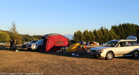 Telescopes and campers on the observing field
