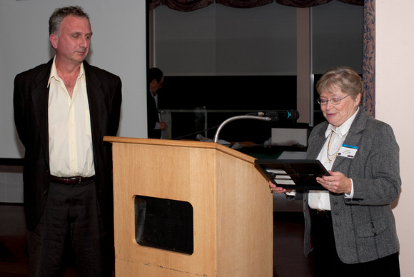 Lauri Roche presents a Volunteer Appreciation Certificate to Mark Bohlman