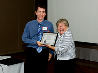 Matt Watson receives a Volunteer Appreciation Certificate for his work with the Victoria Centre Observatory