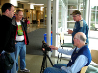 John McDonald demonstrating astrophotography gear to Charles Banville, Joe Carr and Bill Weir