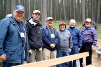 Chris Gainor, Charles Banville, Bruno Quenneville, Frank Ogonowski, Joe Carr, & Jim Hesser standing in the rain